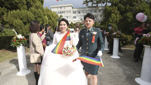 Two same-sex couples make history in Taiwan military mass wedding