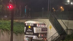 220 bus gets stuck under bridge in Douglas after wrong turn