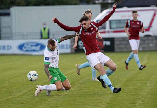 Conor Drinan, Cobh Ramblers, battling Daniel Blackbyrne, Cabinteely, at St Colman's Park on Saturday night. Picture: Jim Coughlan.
