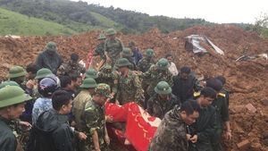Rescuers search for 22 buried as Vietnam landslide hits army camp