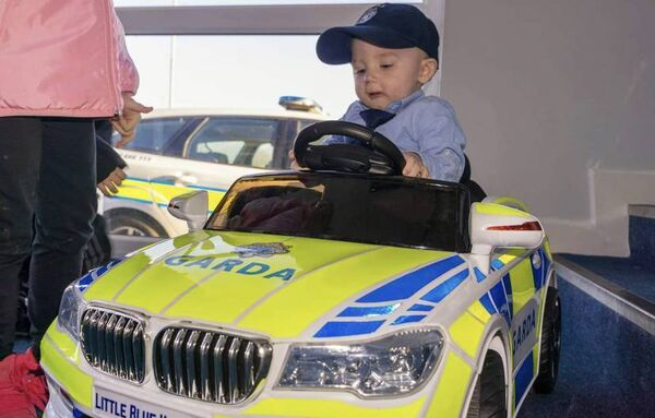 The late Tyler Ryan in a toy Garda Patrol car. His mother fundraised for a fleet of toy Garda cars for sick kids. Pic courtesy of family.