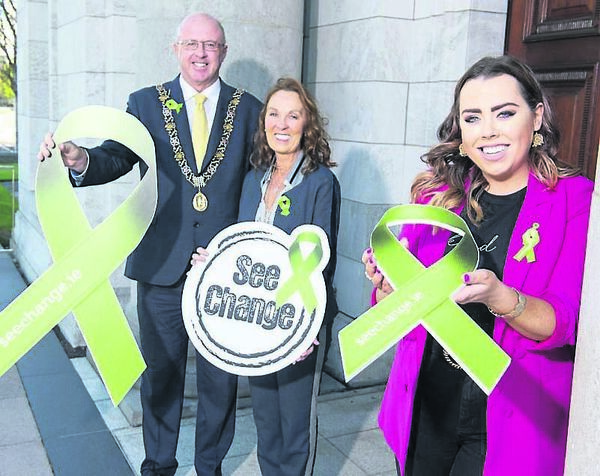 Lord Mayor of Cork Cllr Joe Kavanagh, with Stephanie Kavanagh Lady Mayoress of Cork, and See Change Ambassador Holly Fehily, at the launch of the Annual Green Ribbon Campaign.	Picture: Gerard McCarthy