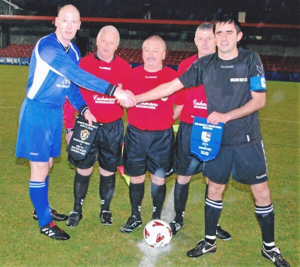 Joe Monaghan (Marlboro Trust), right, exchanges pennants with Martin Hayes (EMC) before the Sports Gear Direct Shield final at Turner's Cross in 2010. Assistant Bertie Stark, referee Tony Murphy and assistant John Quinn look on. Picture: Finbarr Buckley