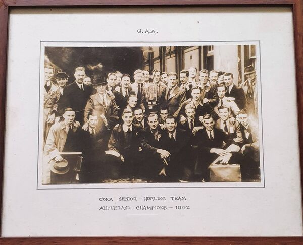 A framed photo of the 1942 All-Ireland winning Cork hurling team before they departed Dublin, Eddie Hogan is in the front row, to Christy Ring's right.