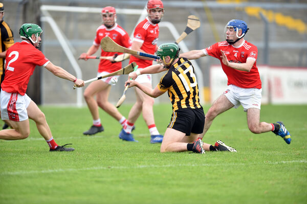 Kilbrittain's Philip Wall is tackled by Castlemartyr's Barra O'Tuama and Cathal Martin during the Co-Op Superstores Cork LIHC at Pairc Ui Rinn
