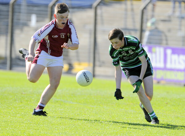 Douglas, Brian O'Hehir about to collect the ball against Bishopstowns, Bill Cahill in the U14 P1FC final at Pairc Ui Rinn. Pic: Gavin Browne