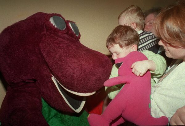Barney being mobbed by enthusiastic youngsters at the Barney and Teletubbies show in the Everyman Palace theatre, 1998. Picture: Richard Mills.