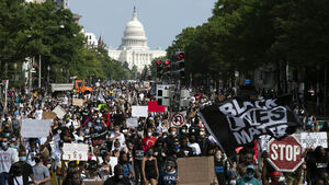 Thousands march on Washington in protest over racist violence