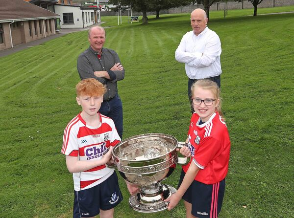 Teddy McCarthy and John Considine with Sean Sheehan and Aoife McCarthy, both 6th class.