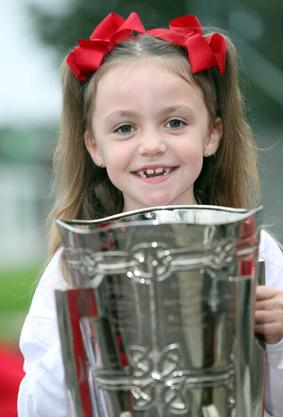 Zara Morey, 2nd class, with the Liam McCarthy Cup.
