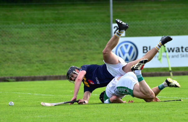 Ronan Crowley, Bandon. going to ground in this clash with John McLoughlin, Kanturk. Picture: Dan Linehan