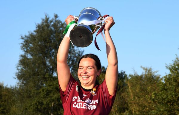 Enniskeane captain Kate McCarthy lifting the Nano Nagle Cup. Picture: Denis Minihane.