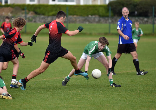 Sean Lynch about to win the ball from the boot of Crosshaven's Shay Murphy. Picture: Eddie O'Hare
