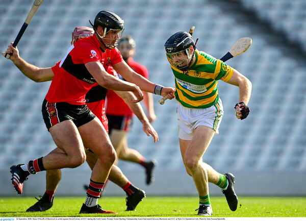 Shane O'Keeffe of Blackrock tries to get past David Lowney of UCC. Picture: Eóin Noonan/Sportsfile