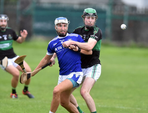 Nemo Rangers' Barry Cripps and Brian Dillon's Tomás Lawrence tussle for the sliotar at Ballinlough. Picture: Eddie O'Hare
