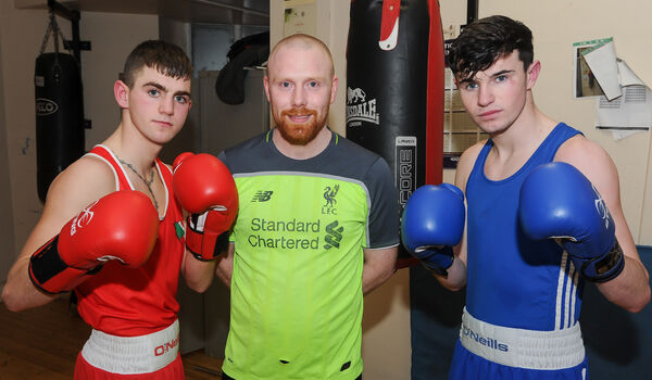 Coach Paul Duncliffe with Owen McDonagh from Mahon and Thomas McCarthy from Mayfield, at a training session at Leeside Lough boxing club.