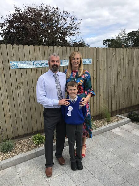 Neville with his wife Melissa and his son Eoin. Neville and Melisssa celebrated their 13th wedding anniversary, while Eoin received his First Holy communion last Saturday.