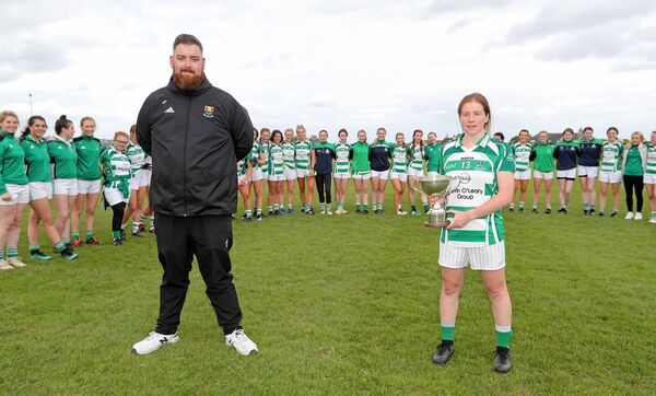 Harry Harvey, Cork LGFA presented Michelle O'Regan, Valley Rovers, with the Cup against beating Douglas last weekend. Picture: Jim Coughlan.