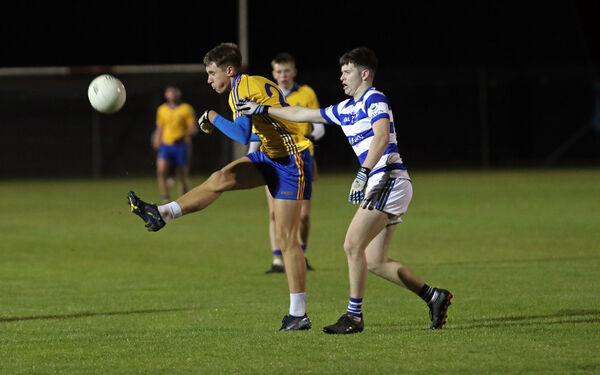 Fionn Crowley, St Finbarr's, is tackled by Adam O'Donoghue, Castlehaven. Picture: Jim Coughlan