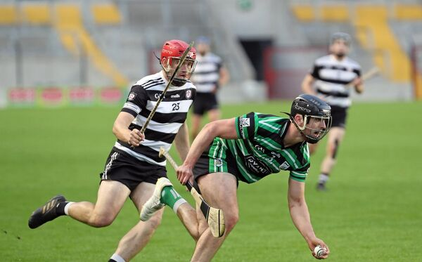 Jake Hegarty, Midleton, pursues Conor Kingston, Douglas. Picture: Jim Coughlan.