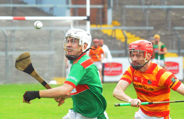 Paudie McMahon of Fr O'Neill's winning the ball from Tadgh Twomey of Newcestown. Picture: Denis Minihane.