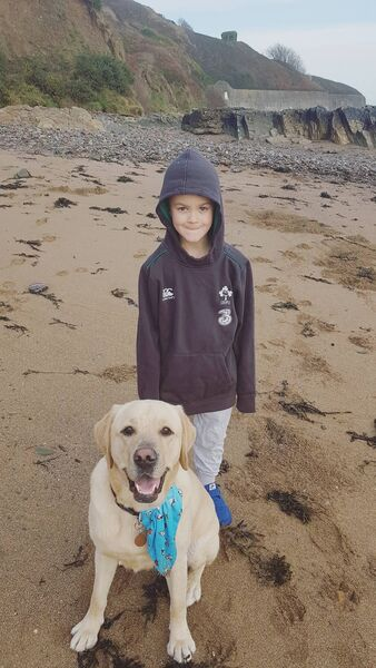 Bodhi with Ebi, his assistance dog.
