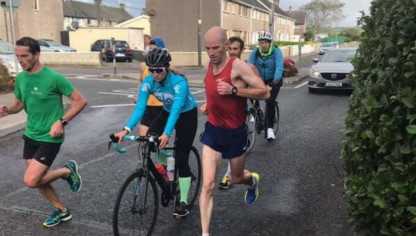 Members of the local Youghal Athletic Club setting the pace for Sebastian Helka.