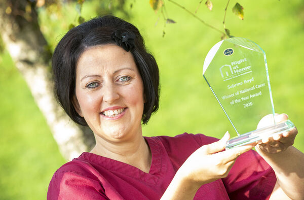 Home carer Sabrina Boyd, from Cork City, with the Right at Home Ireland Carer of the Year 2020 award. Picture Gerard McCarthy