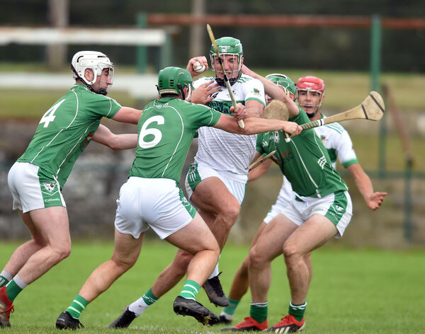 Aidan Walsh tackled by Killeagh's Dylan Hogan, Cian Fogarty and Chris Coughlan. Picture: Eddie O'Hare