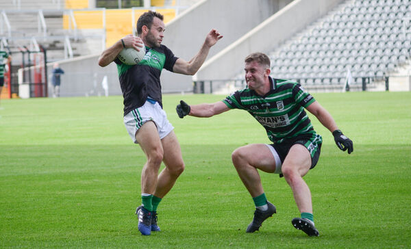 Nemo Rangers' Alan Cronin evades the challenge from Luke McGrath. Picture: Howard Crowdy