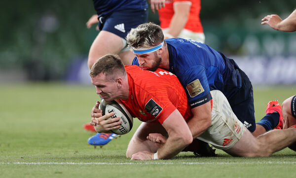 Munster's Chris Farrell is tackled by Caelan Doris of Leinster. Picture: INPHO/Billy Stickland