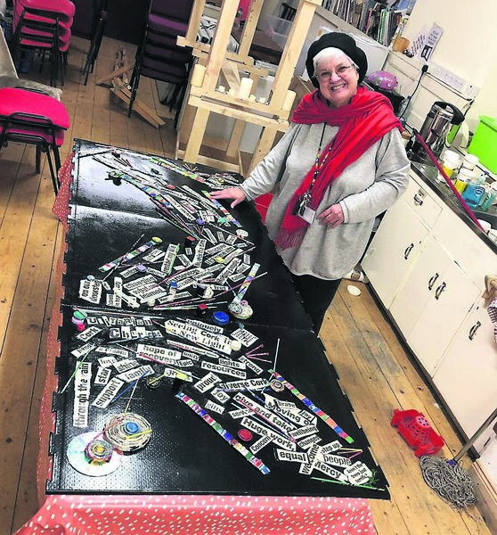 GOOD NEWS STORY: Virginia Giglio putting together her Echo exhibition, which opened at the Unitarian Church in Cork yesterday.