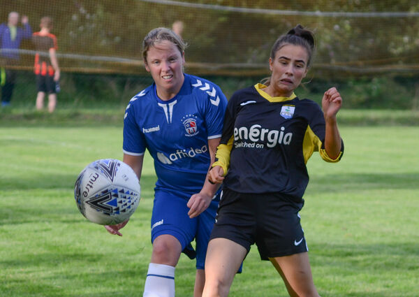 Deirdre Callanan of Wilton and Riverstown's Caoimhe Mulcahy tussle over a loose ball during the GE Healthcare CWSSL Senior Womens Premier League match at Pat Bowdren Park. Picture: Howard Crowdy