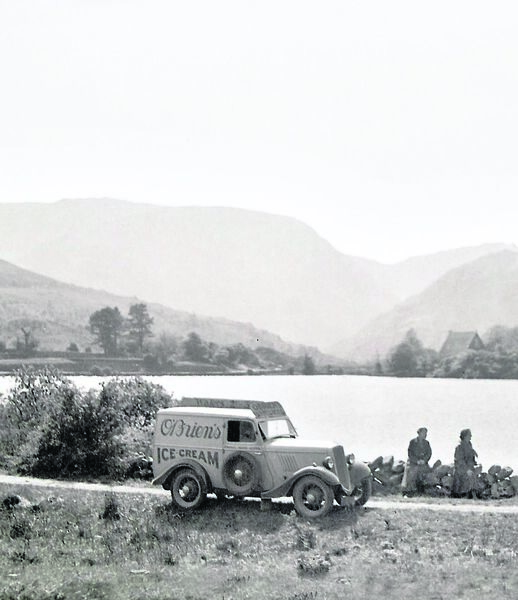 ICE WORK IF YOU CAN GET IT: O'Brien's ice cream van, known as Florrie, at Gougane Barra in the 1930s and (below) crowds flock to buy one on a sunny day.