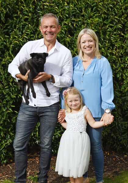 Pete, Fiona and Saoirse Rawlinson at home with the family pet, Sadie.Picture Denis Minihane.