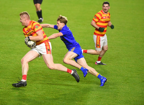 Fionn Keane, Newcestown, gets past a challenge from Sam Ryan, St Finbarr's. Picture: Larry Cummins.