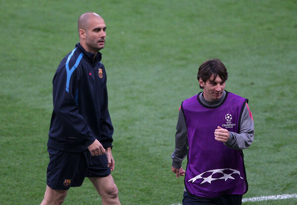 Barcelona manager Pep Guardiola (left) and Lionel Messi together back in 2011. Man City are  one of the clubs in the running to sign Messi reuniting the successful combination in Manchester. 	  Picture: Nick Potts/PA Wire.