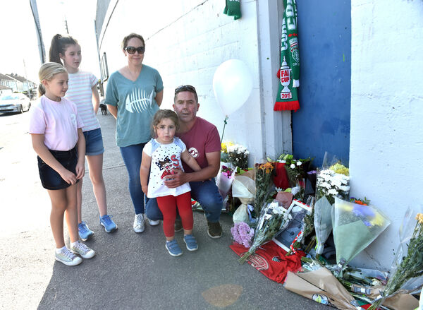 Members of the Coughlan family, Schull and Mayfield, relatives of the late John Kennedy lay flowers to the former Cork City supporter and board member at Turners Cross