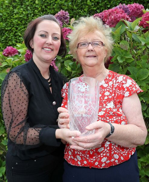 Sabrina Boyd, named Carer of the Year with her mum, Ann, holding Ann's Carer of the Year Trophy from 2012.