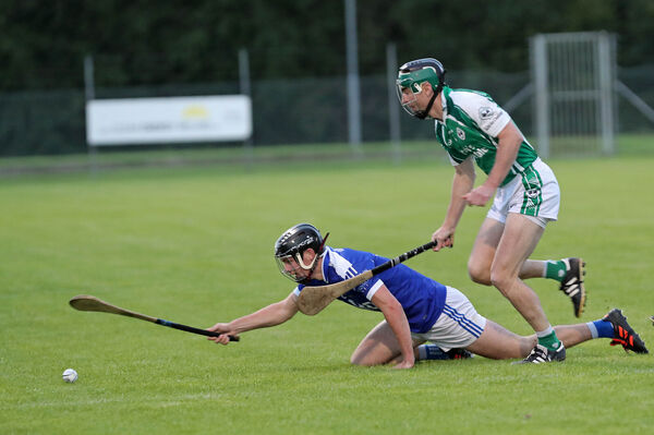 Barry Coleman, Ballincollig, tackles Richard Lombard, Ballinhassig. Picture: Jim Coughlan.