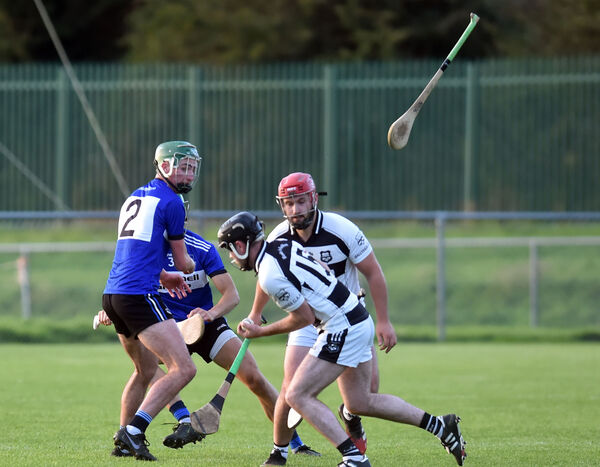 Sarsfields' Cillian Roche loses his hurley against Ballyhea's Eugene O'Leary. Picture: Eddie O'Hare