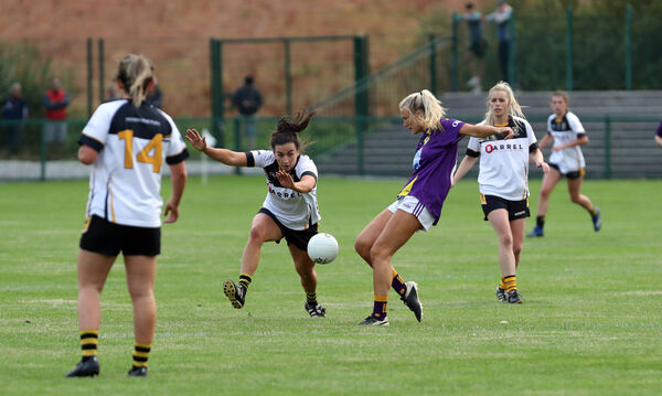 Bríd O'Sullivan, Mourneabbey, tries to block Eve Murphy, West Cork. Picture: Jim Coughlan.