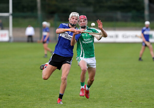 Ben Nodwell, Sarsfields, battles Tadhg O'Connell, Ballincollig. Picture: Jim Coughlan.