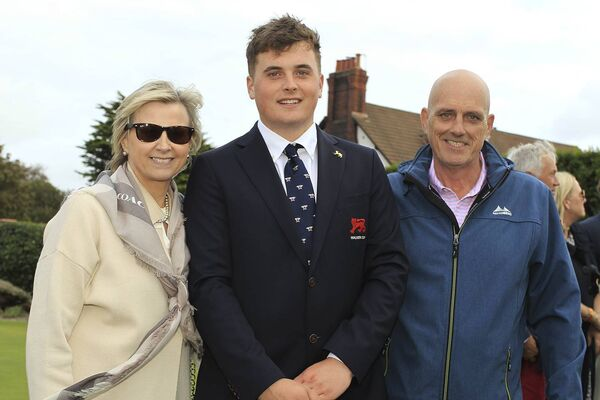 James Sugrue pictured with his parents Margaret and Michael at the Walker Cup opening ceremony. Picture: Niall O'Shea