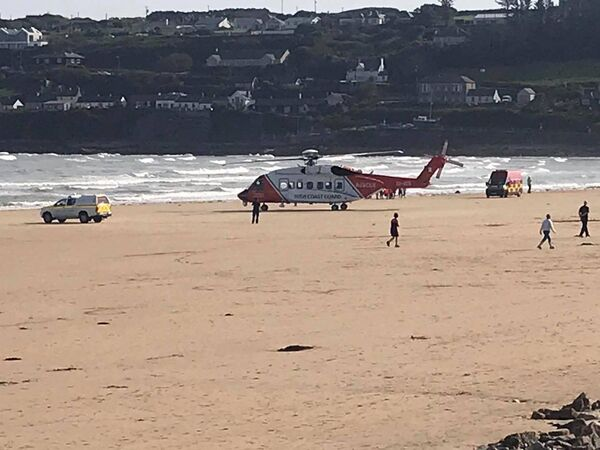 Scenes from Ardmore beach on Saturday 19 September where an off-duty fire fighter from the Midleton Fire Brigade rescued two young children from the water. Pics: Irish Coast Guard
