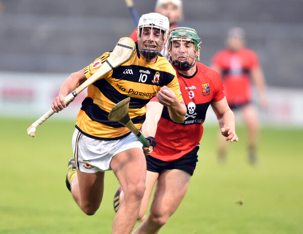 Na Piarsaigh's Shane Forde bursting past UCC's Paddy Cadell to score a goal. Picture: Eddie O'Hare