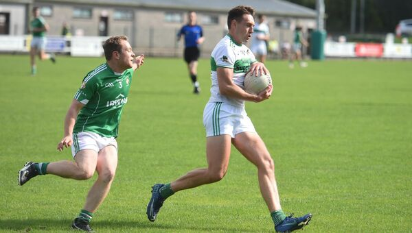 Ian Walsh, Kanturk, shields the ball from Aghada full-back Ed Leahy. Picture: Larry Cummins.