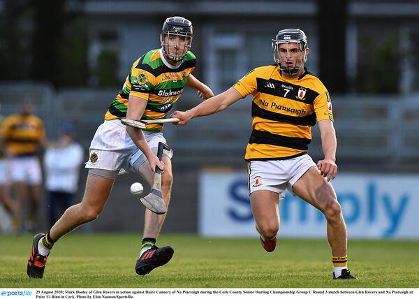 Mark Dooley of Glen Rovers in action against Daire Connery of Na Piarsaigh. Picture: Eóin Noonan/Sportsfile