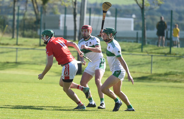 Gavin Kelleher of Charleville in action against Kanturk defenders Alan Sheehy and Paul Walsh in The Co-Op Superstore. Picture: Larry Cummins