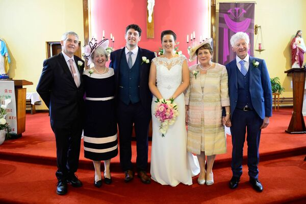 BY THEIR SIDE: The couple with parents George and Kay Osborne and Margaret and Noel O'Sullivan.